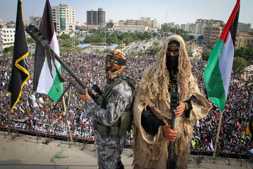 Palestinian Islamic Jihad (PIJ) terrorists stand guard on a roof during a rally marking the 29th anniversary of PIJ's founding in Gaza City on Oct. 21, 2016. Credit: Abed Rahim Khatib/Flash90.
