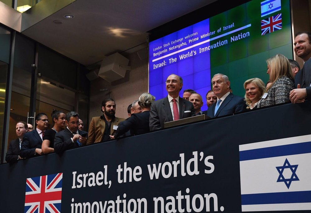 Israeli Prime Minister Benjamin Netanyahu (front, fourth from right) opens trading at the London Stock Exchange on Friday. Credit: Kobi Gideon/GPO.