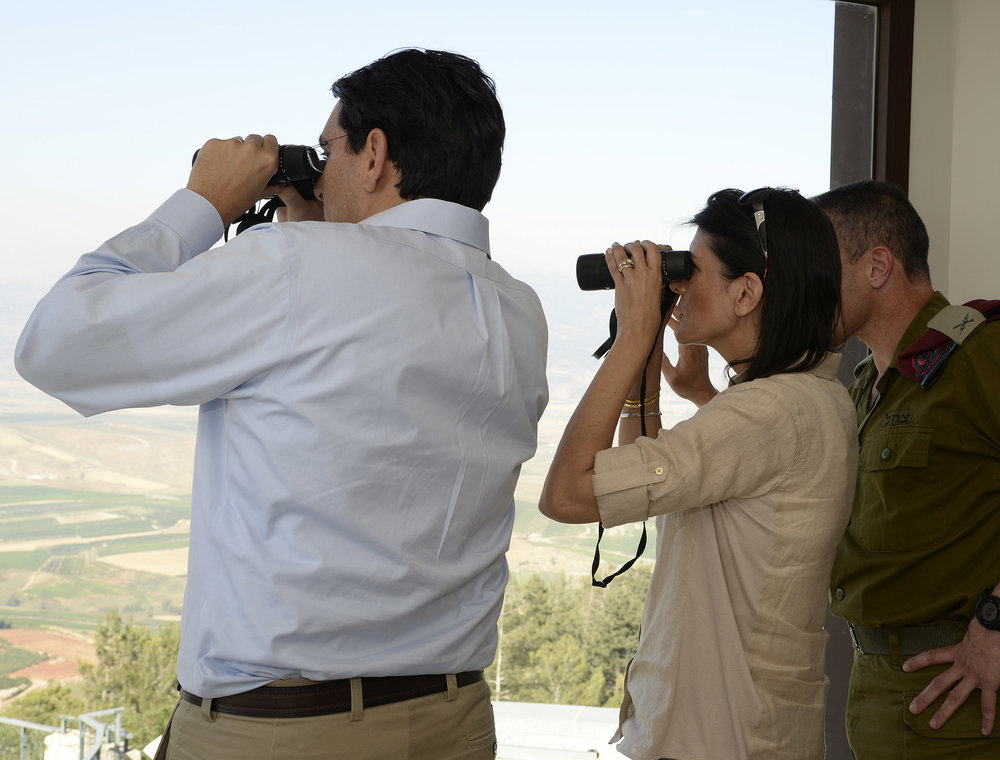 During a visit to northern Israel in June 2017, Israeli Ambassador to the United Nations Danny Danon (left) and U.S. Ambassador to the U.N. Nikki Haley (center) look out over southern Lebanon. Credit: Matty Stern/U.S. Embassy Tel Aviv/Flash90.