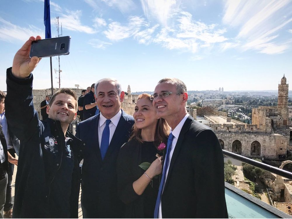 Ioana Isac (second from right), the 3 millionth tourist to visit Israel this year, and her partner Mihai Georgescu (left) get an exclusive tour with Prime Minister Benjamin Netanyahu and Tourism Minister Yariv Levin at Jerusalem's Tower of David Museum. Credit:Kobi Gideon/GPO.