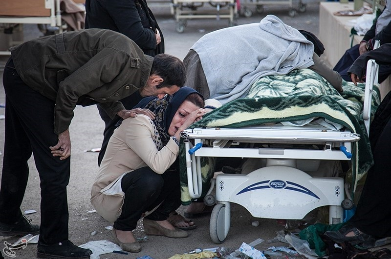 Relatives mourn a victim of Sunday's earthquake in Iran. Credit:Tasnim News Agency via Wikimedia Commons.