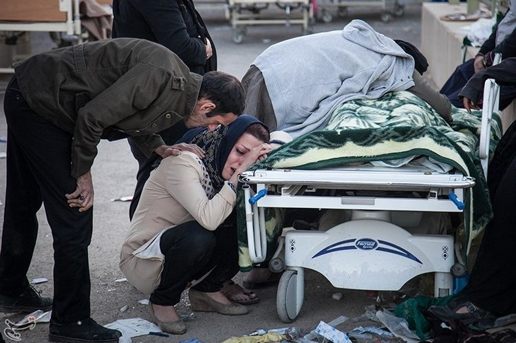 Relatives mourn a victim of last Sunday's earthquake in Iran. Credit:Tasnim News Agency via Wikimedia Commons.