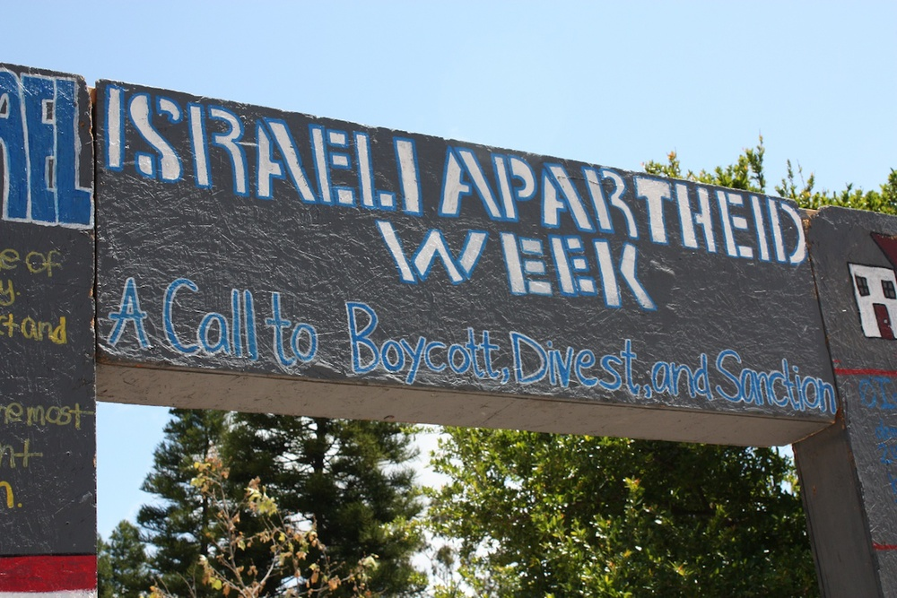 """A BDS display during """"Israeli Apartheid Week"""" in May 2010 on the University of California, Irvine campus. Credit: AMCHA Initiative."""