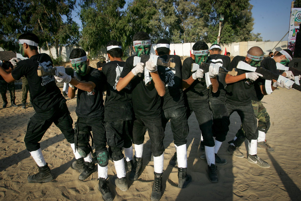 Palestinian youths participate in the graduation ceremony for a military-style camp organized by the Hamas terror group in Gaza on Aug. 18, 2017. Credit: Abed Rahim Khatib/Flash90.