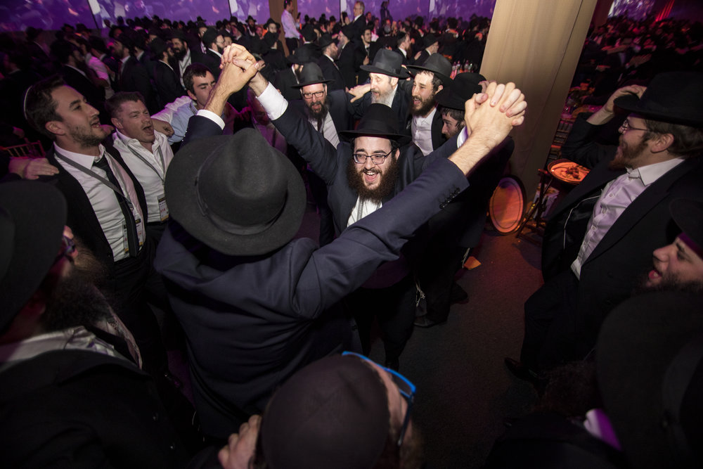 Emissaries and other guests rejoice during the Chabad-Lubavitch movement's 44th annual Kinus Hashluchim (gathering of emissaries) in Bayonne, N.J., on Nov. 19. Credit:Chabad-Lubavitch