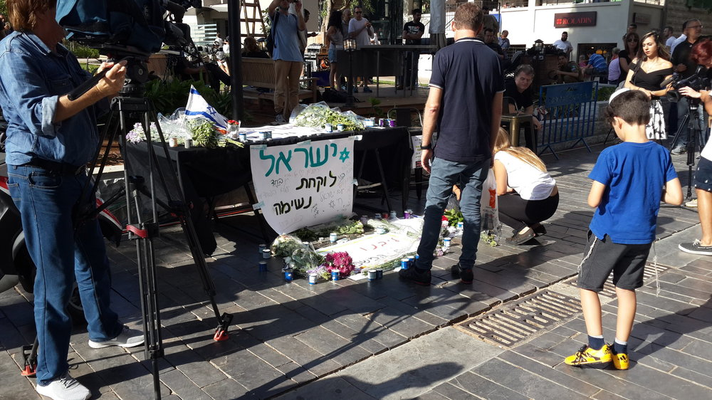 A memorial for the victims of the June 2016 Palestinian terror attack in Tel Aviv's Sarona Market. Credit: Wikimedia Commons.