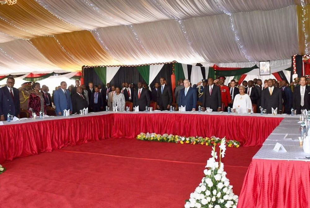 Israeli Prime Minister Benjamin Netanyahu (at table, fifth from right) attends a lunch event at Kenya's presidential palace on Nov. 28. Credit: Haim Zach/GPO.