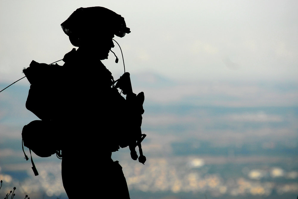 An IDF soldier standing guard at a military base in Israel's northern Golan Heights region. Credit: IDF.
