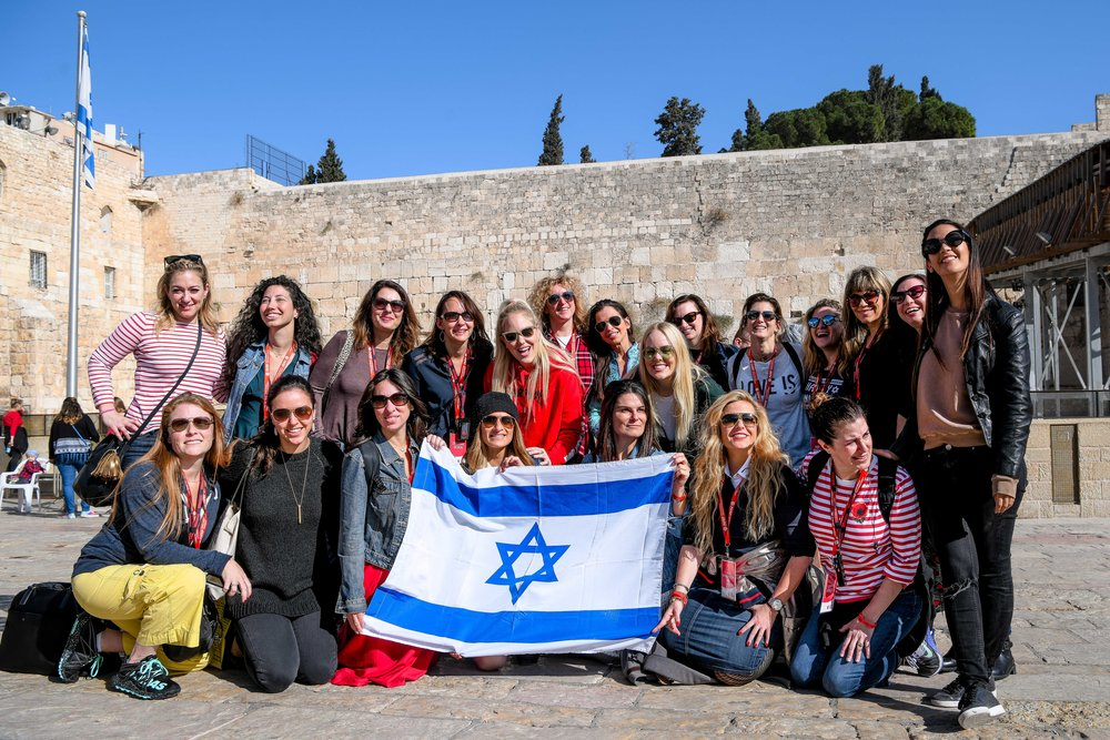 """Participants of the Jewish Women's Renaissance Project's """"Media Magnets"""" trip to Israel are pictured at the Western Wall in Jerusalem. Credit: Aviram Valdman."""