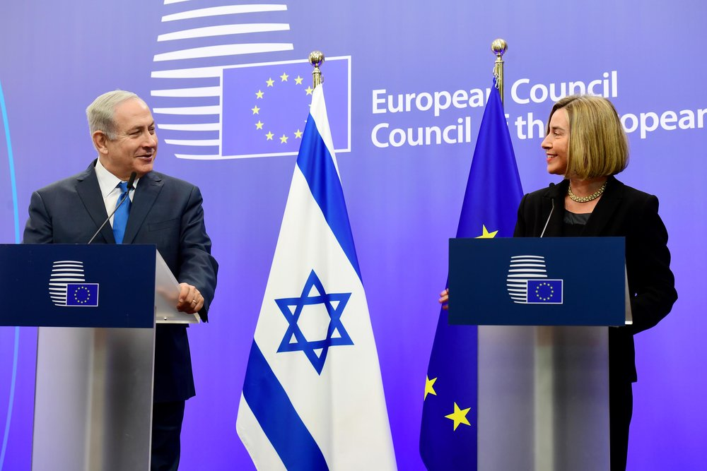 Israeli Prime Minister Benjamin Netanyahu makes a joint appearance with the European Union's diplomatic chief, Federica Mogherini, in Brussels on Monday. Credit: Avi Ohayon/GPO.