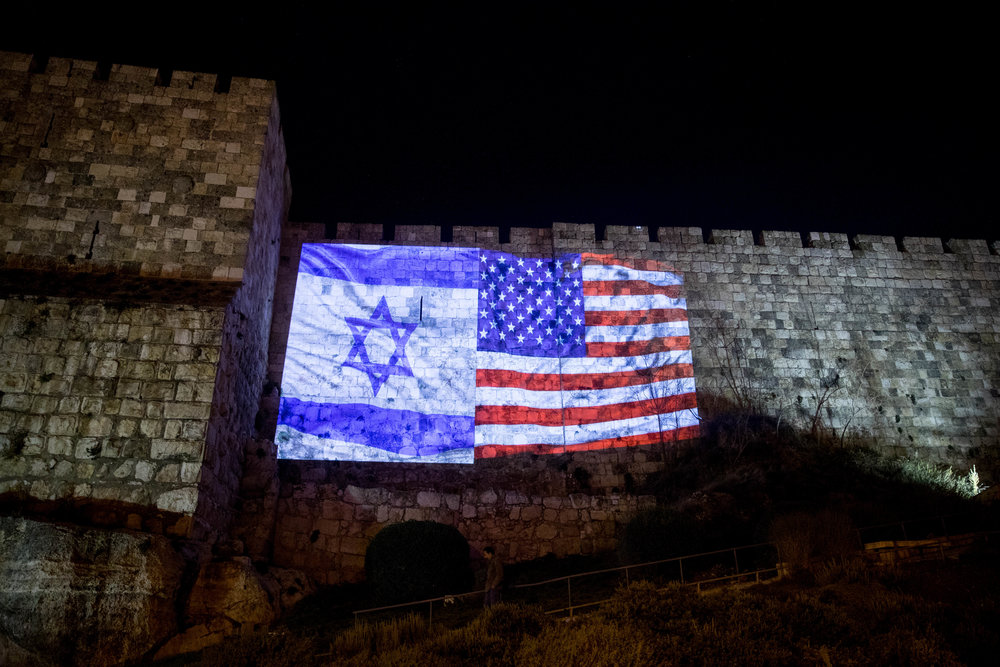 Images of Israeli and American flags are projected on the Old City walls following President Donald Trump's recognition of Jerusalem as Israel's capital. Credit: Yonatan Sindel/Flash90.