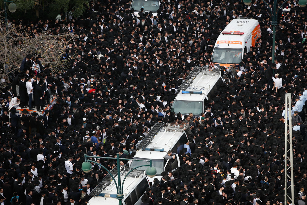 Thousands of followers of Rabbi Aharon Yehuda Leib Shteinman attend his funeral in Bnei Brak on Dec. 12, 2017. Credit: Yonatan Sindel/Flash90.