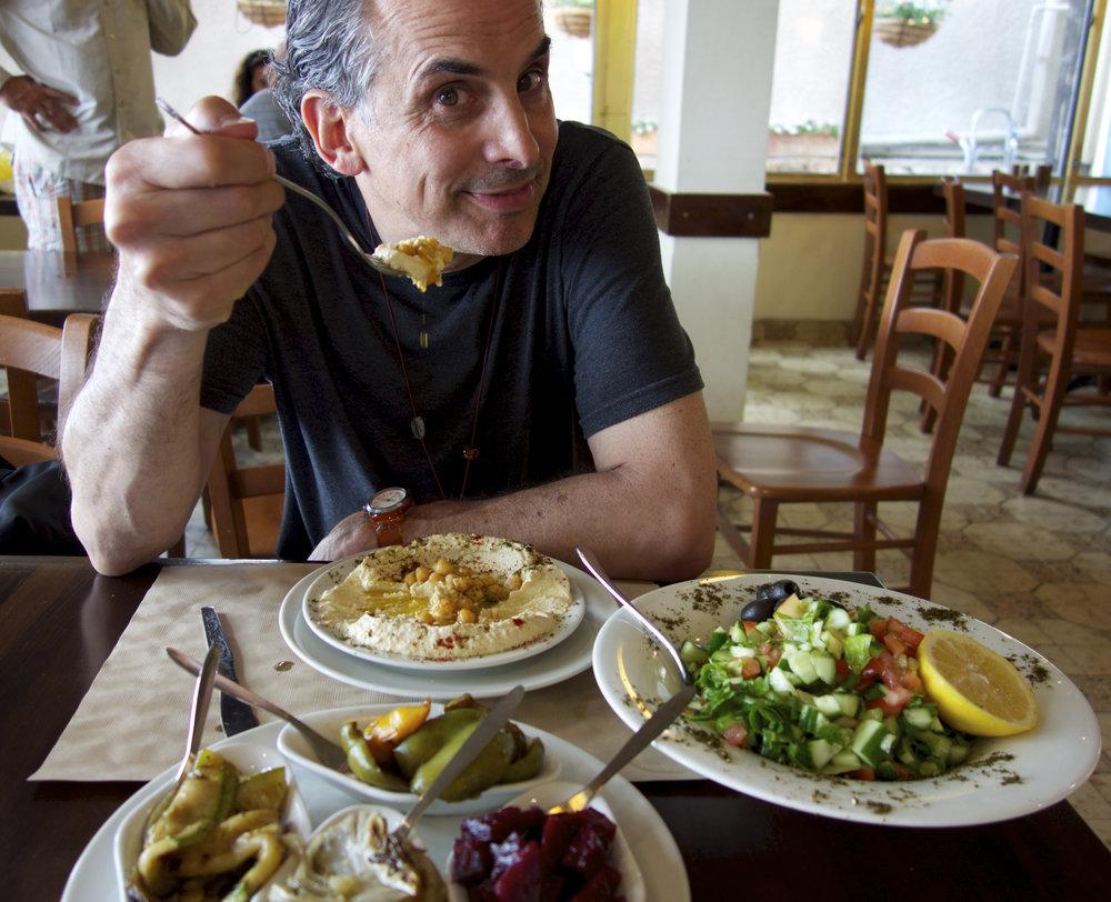 "Film director Roger Sherman samples Israeli cuisine. Credit:""In Search of Israeli Cuisine"" press photo."