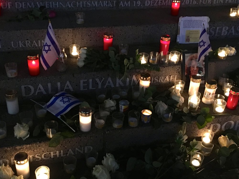 Israeli flags surround the name of Dalia Elyakim, an Israeli woman killed in the 2016 Berlin Christmas market terror attack, within a memorial to the attack's 12 victims. Credit: Orit Arfa.