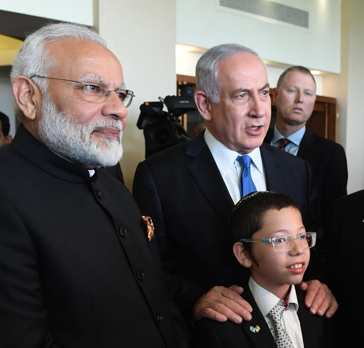 In July, Indian Prime Minister Narendra Modi (left) and Israeli Prime Minister Benjamin Netanyahu meet with 11-year-old Moshe Holtzberg, whose parents were killed in a terror attack on the Chabad House in Mumbai in 2008. Credit: Haim Zach/GPO.