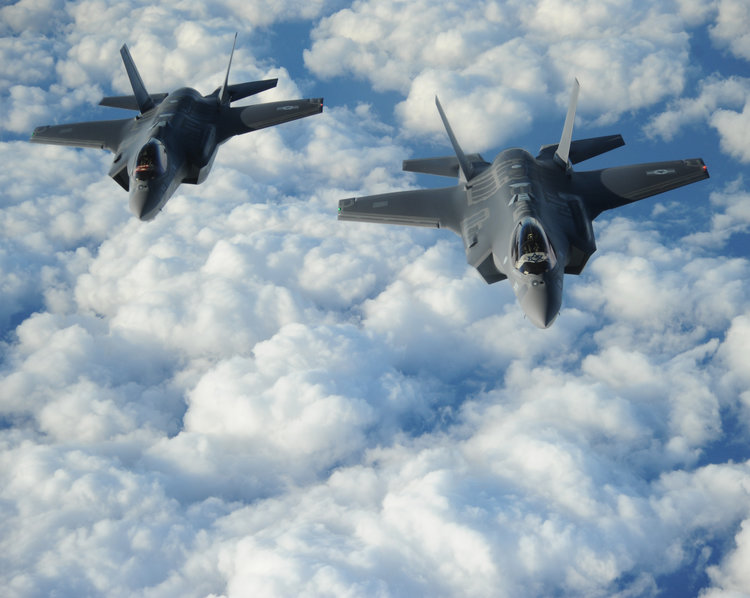 """Two Israeli F-35 """"Adir"""" jets fly in formation after receiving fuel from a Tennessee Air National Guard KC-135 on Dec., 6, 2016. Credit: U.S. Air Force/1st Lt. Erik D. Anthony."""