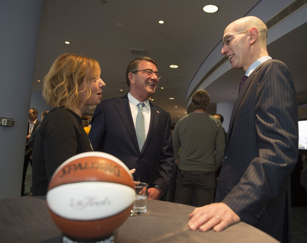 NBA Commissioner Adam Silver (right) speaks with then-Secretary of Defense Ash Carter in June 2016. Credit: DoD photo by Navy Petty Officer 1st Class Tim D. Godbee/Released.