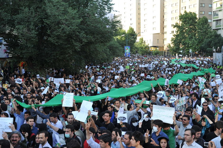 "An anti-regime protest in Tehran during the ""Green Revolution"" in June 2009. Credit: Milad Avazbeigi via Wikimedia Commons."