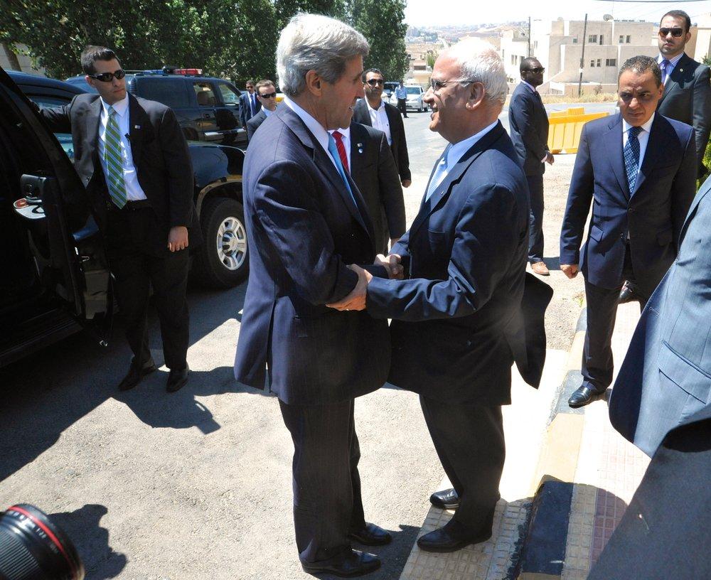 Palestinian Authority lead negotiator Saeb Erekat (center, right) greets then-Secretary of State John Kerry in Amman, Jordan,in June 2013. Credit:U.S. Department of State