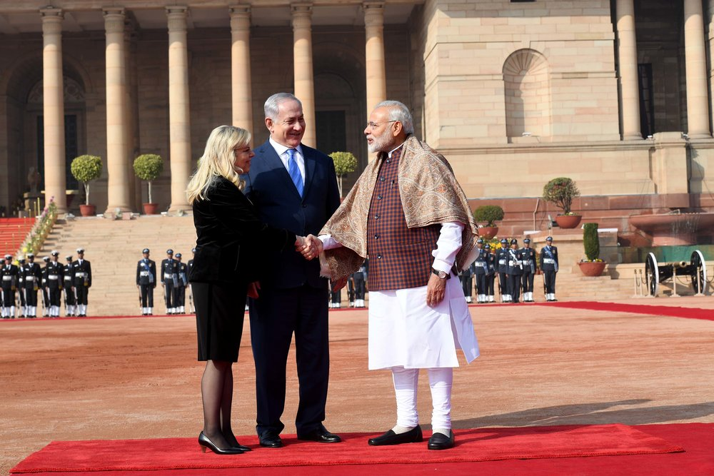 Prime Minister Benjamin Netanyahu (center) and his wife Sara are welcomed by Indian Prime Minister Narendra Modi at the Presidential Palace in New Delhi. Credit:Avi Ohayon/GPO.