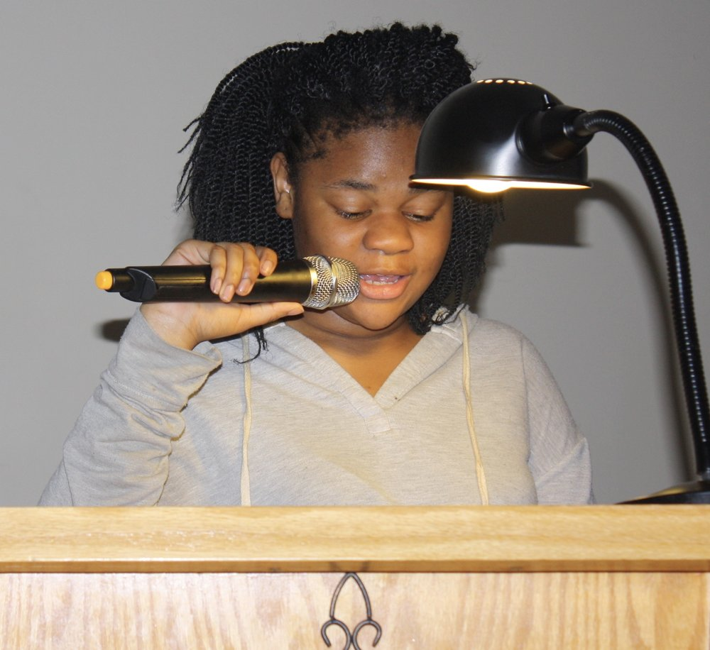 Youth Reading Scripture During Ash Wednesday Service