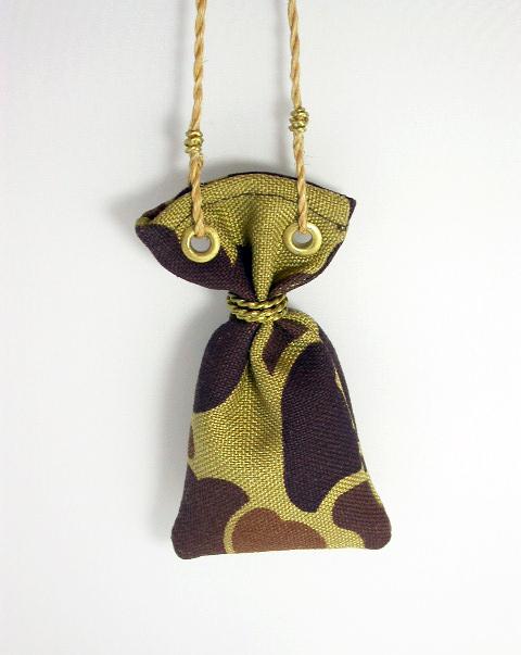'Payload' Pendant 2011, canvas, brass, muka cord, pumice.