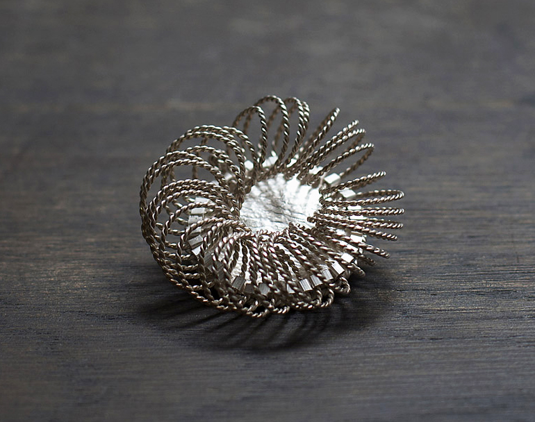 Cycle Brooch, 2012, sterling silver.