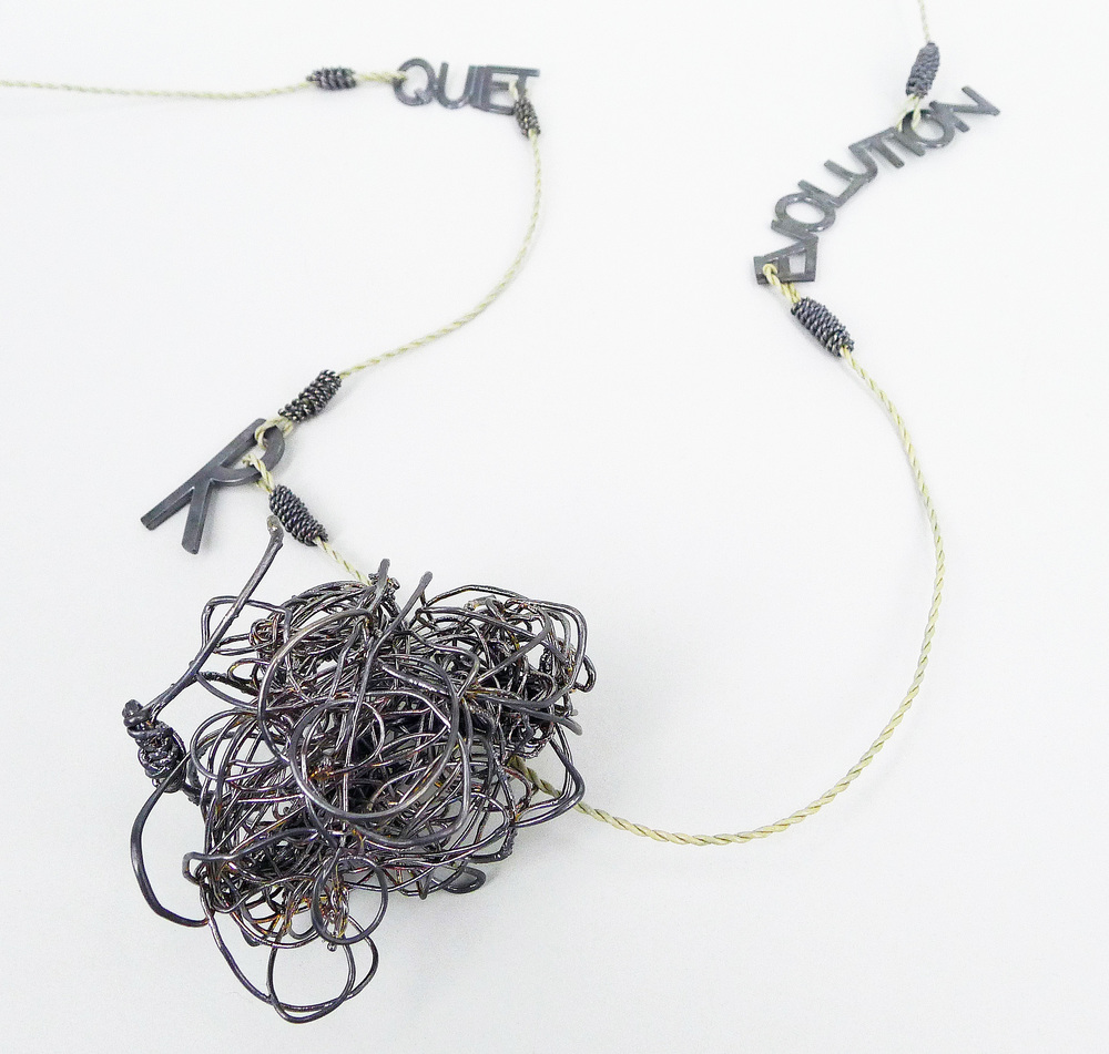'Quiet Revolution' Necklace  Oxidised 18ct gold, oxidised stg silver, rubber coated electrical wire cord, hearing aid parts (clasp not shown), enamel paint