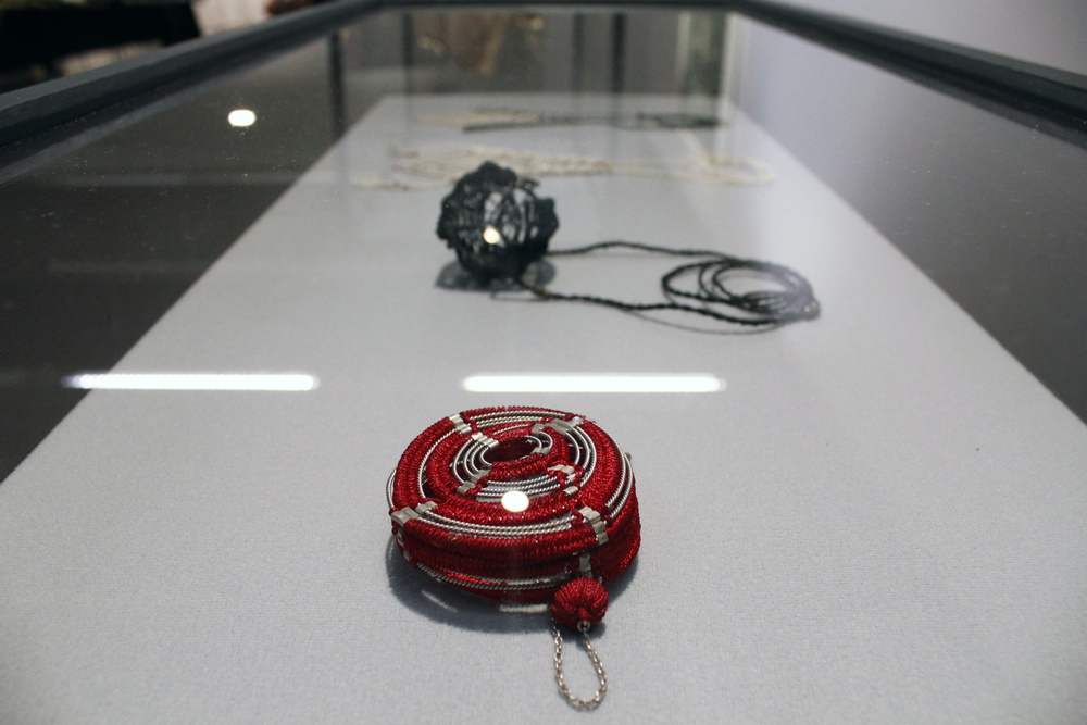 Installation of work during the exhibition showing Weave brooch, Space pendant and 'Twelve' neckpieces (set of two)