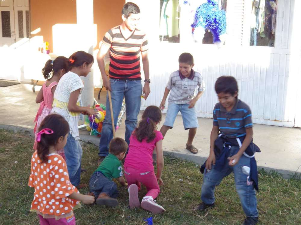 Each child chose an adult to hit the piñatas and then the kids in the audience scrambled to grab candy.