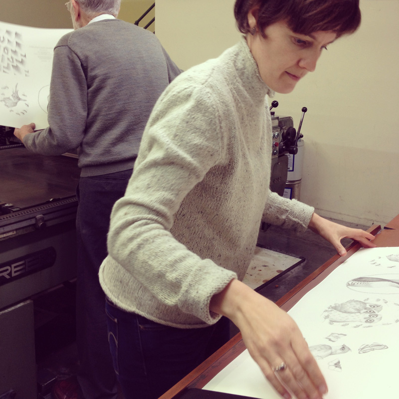 Louise, at Bernie Rackham's side, printng  A Flight of Twelve Southern Hemisphere Birds  at Redwood Print