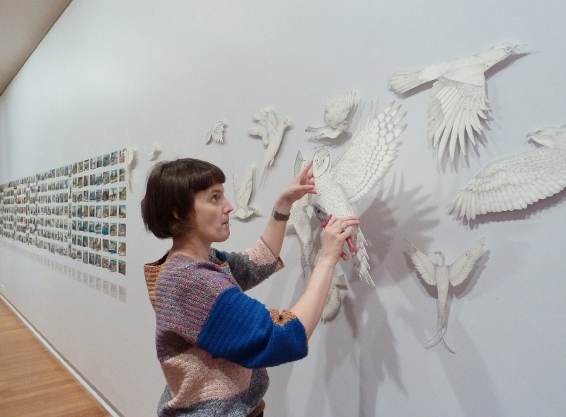 Gracia Haby & Louise Jennison, de-installing artwork as part of All breathing in heaven at Geelong Gallery, 2013
