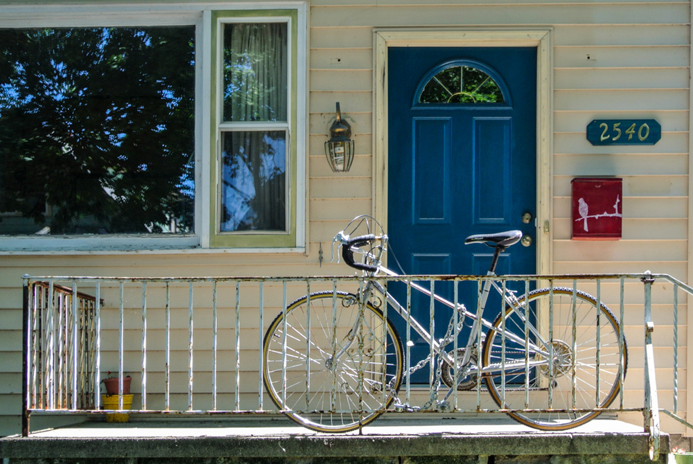 Taken in a recent trip to Milwaukee, the bike, the bird on the red mailbox, the bright blue door, the reflection of the trees in the window.  This house was a perfect subject for a photograph.