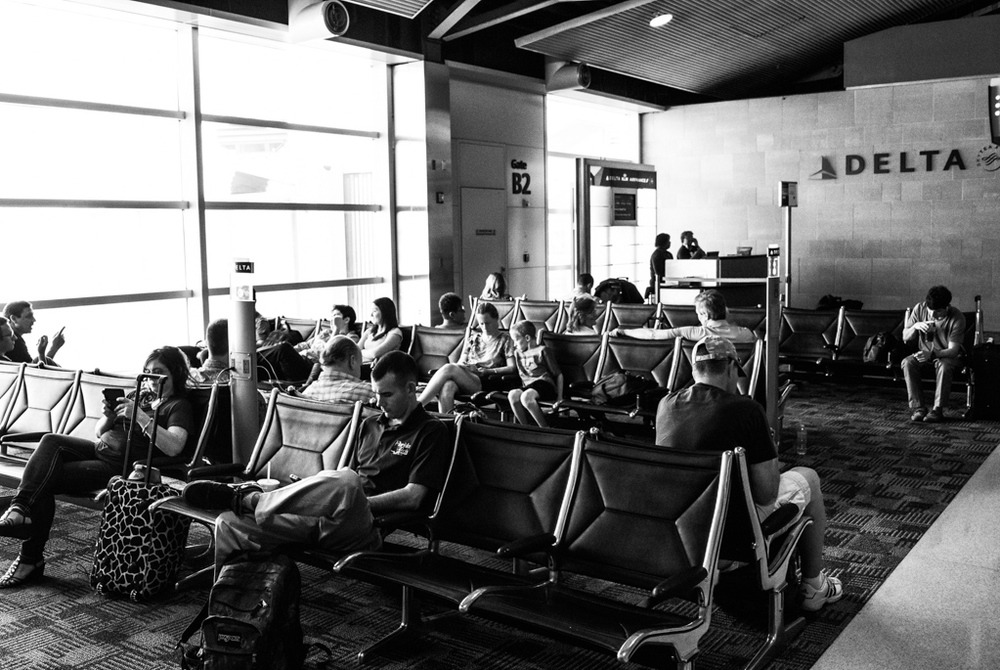 This time the waiting is taking place in Detroit (the now bankrupt city), between flights.