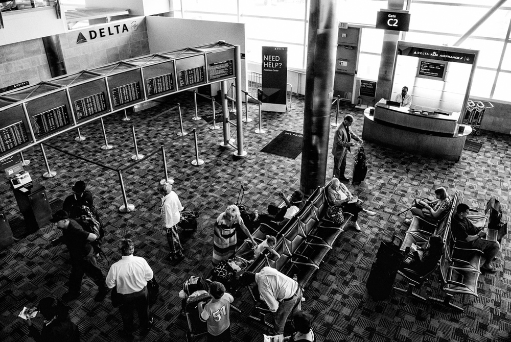 Travelers doing what travelers do when they travel. Detroit, Michigan: The now bankrupt city.