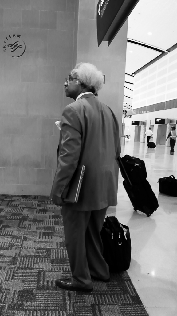 You see lots of interesting people in airports.  This man and his hair and nice clothing made him look interesting to me.  What is really interesting is that after taking his picture in Detroit, I saw him twice this weekend in Madison.  No suit, but same hair!