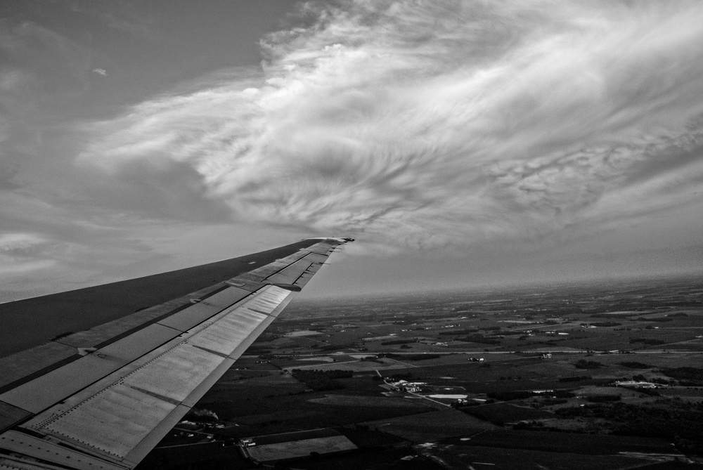 This cloud looked pretty amazing out my window on the flight to Madison.  It was nearing sunset so the color was very pretty.  Here it is in black and white - in keeping with my Black and White theme for this little series.  Maybe I will share it with you in color once this series comes to an end.