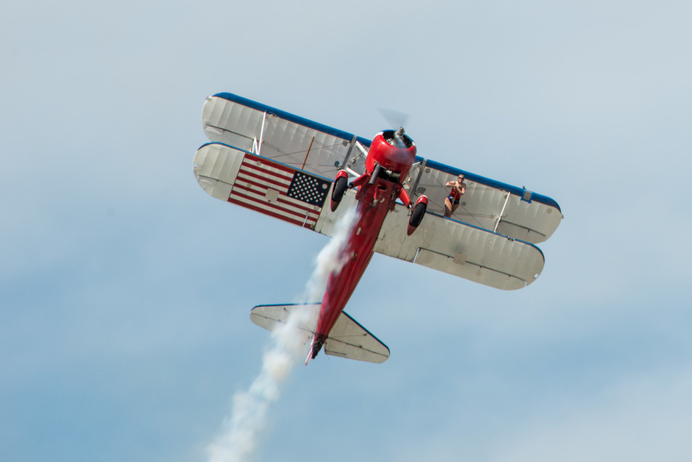 This is yesterday's wing walker before she started to do her walking.  I think the American Flag on the bottom of the wing is a nice touch! Photographed at EAA AirVenture in Oshkosh, Wisconsin.