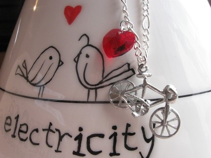michael and sabriney bicycle bike necklace