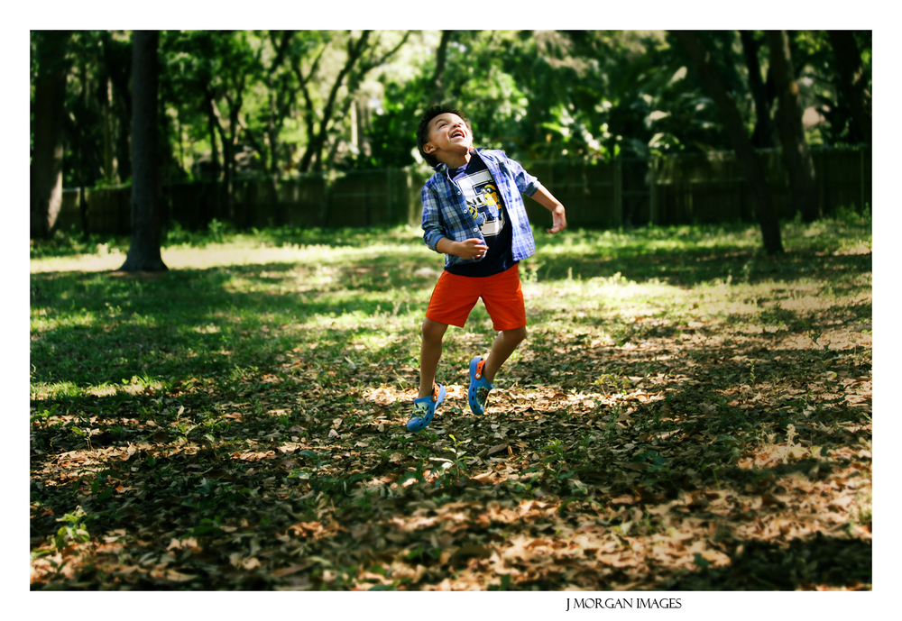 boy jumping outside