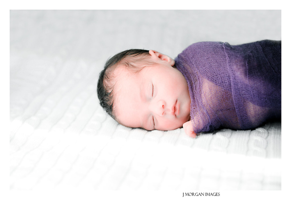 baby in purple cheese cloth wrap