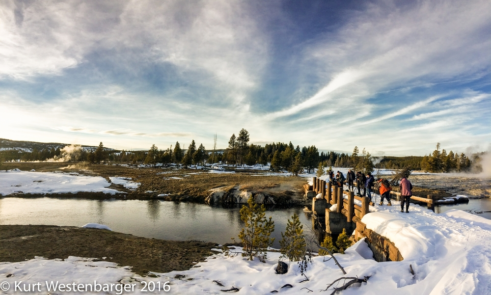 Mark Thiessen advising the group on how to photograph  sunset over the Firehole River in Yellowstone National Park.