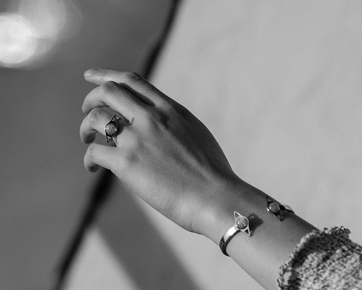 Tessa May Corbett wearing the Lunar ring and Voyage cuff in opal