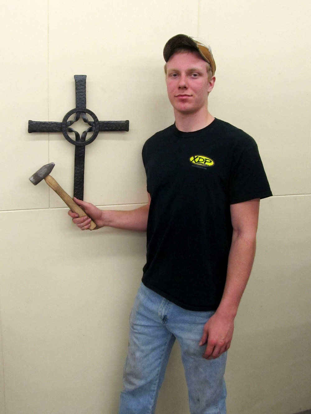 AJ with Cross and Hammer.JPG