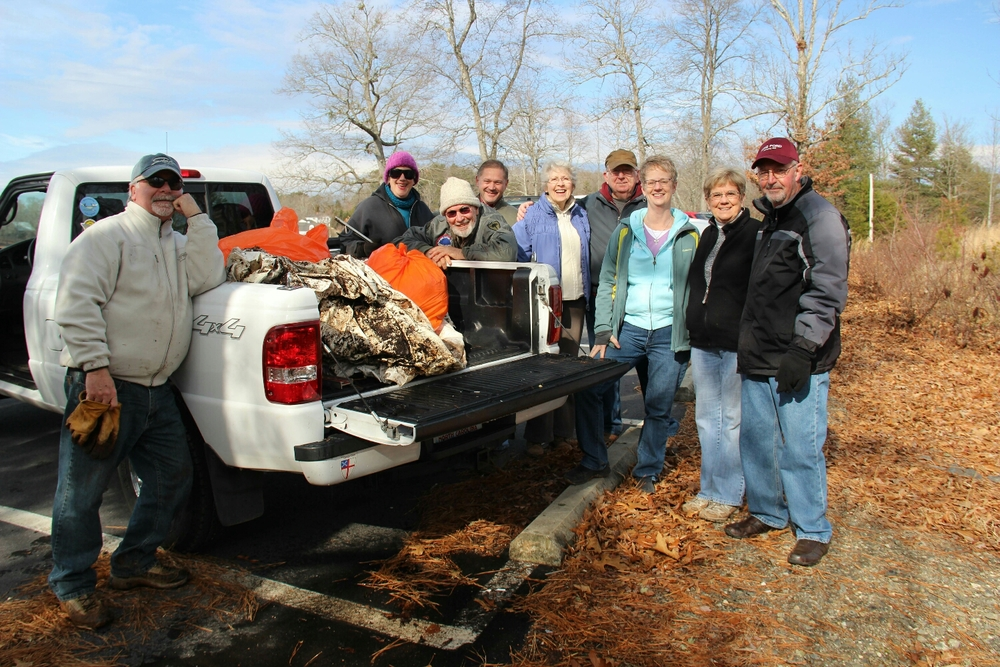 Pictured:  Jim Redmond, Meg Gring Whitley, Fred King, Bill Breedlove, Mary Stewart King, Howard McDaniel, Susan Morgan, Betsi Wilson, and Chuck Underwood with their haul from the Ledford Chapel boat ramp. Photo credit: Alan Sirmans