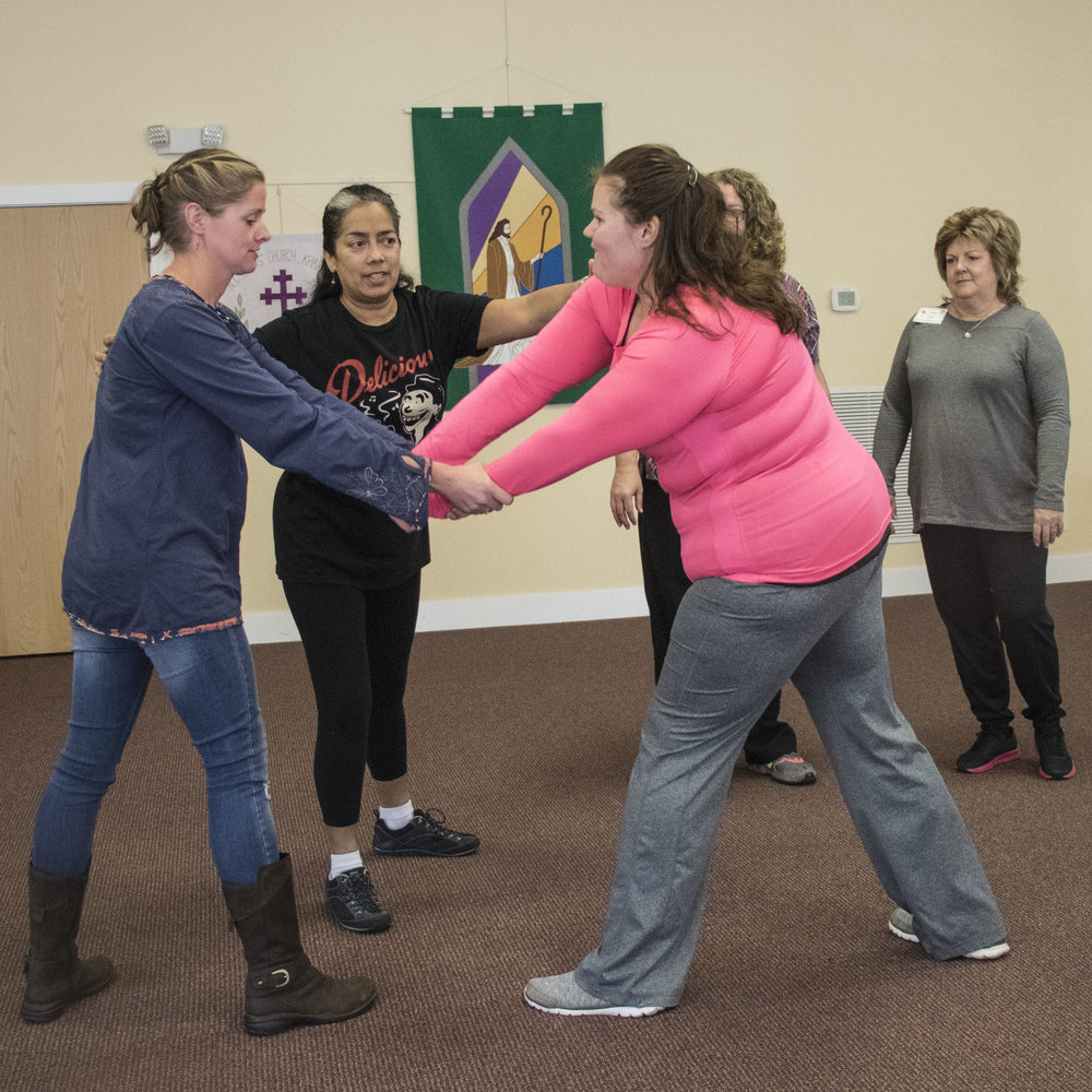 Cameron Green, Judith Alvarado, Amanda Guitierrez, Tracey Cothren, Susan Gray in a self defense class.