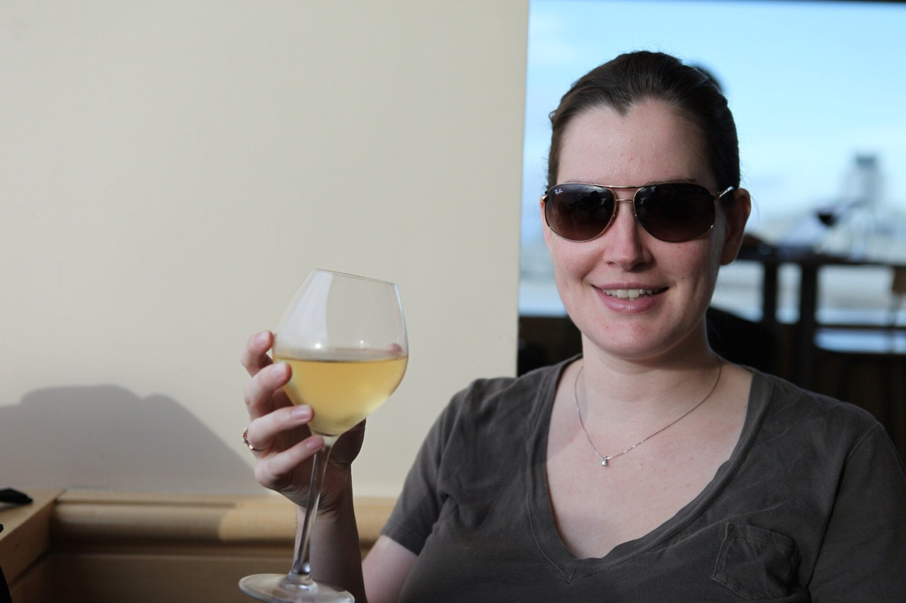 Let the fun begin! Johanna enjoys a glass of wine in SFO's lounge.