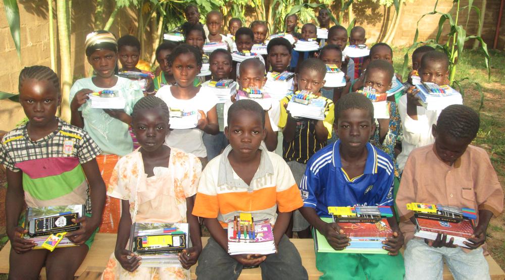 children-with-school-supplies.png