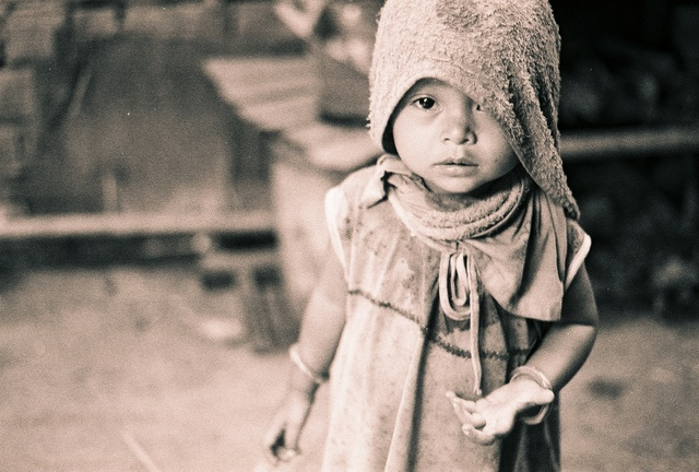 A Cambodian child extends her hand. Making you feel guilty.