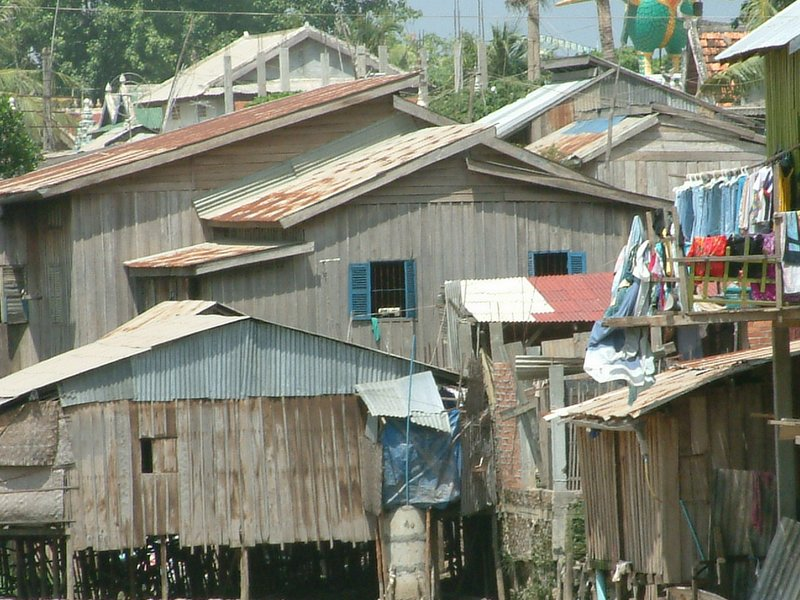 The house with blue windows in this photo was our second home in this slum, built over a sewer canal. Eventually we were all evicted to make way for an overpass.